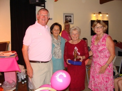 Pink chairty golf prize giving